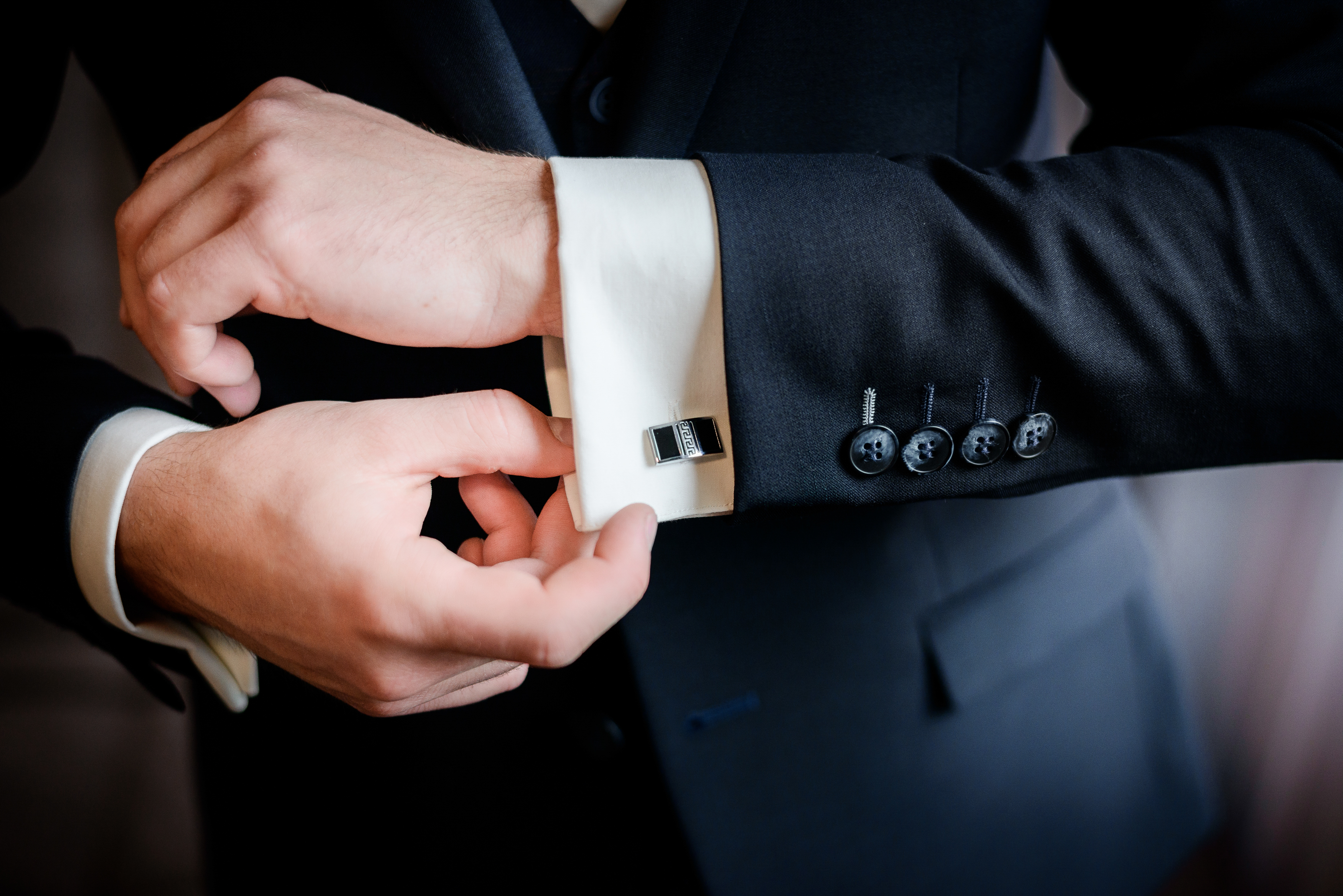 Beautiful stylish groom's cufflinks on the shirt