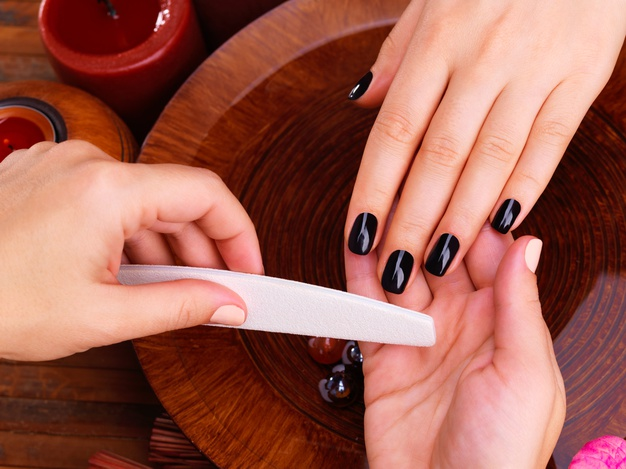 manicurist-master-makes-manicure-woman-s-hands-spa-treatment-concept_186202-7770